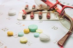 Pill and calender Royalty Free Stock Images