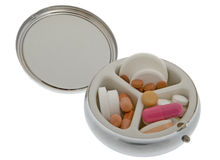 Pill can with tablets Royalty Free Stock Photo