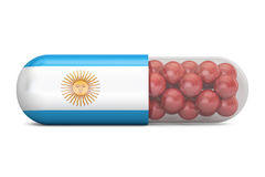 Pill capsule with Argentina flag. Argentine health care concept, Stock Photo