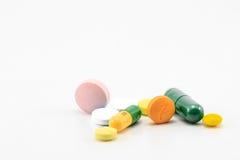 Pill. A capsule care disease doctor grain green stock image