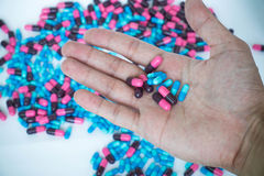 Pill capsule on hand. With pill background Stock Photo