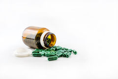 Pill capsules spilling out of a bottle Royalty Free Stock Photos