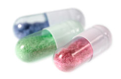 Pill capsules with toxic looking content. Pill capsules with an artificial and toxic looking content Stock Images