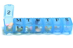 Daily pill container Royalty Free Stock Images
