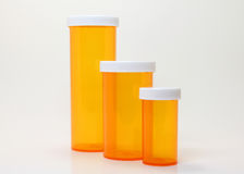 Pill Containers. Three pill containers, different sizes; white background Royalty Free Stock Photography