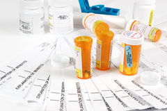 Pill containers & insurance statements Stock Photo