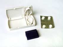 Pill cutter and white tablets Stock Photo