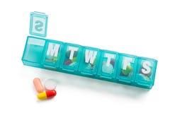 Pill dispenser Royalty Free Stock Photo