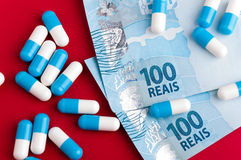 Pill drug and Brazilian money Stock Photo