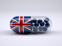 Pill with England flag wrapped around it and blue ball inside Stock Photo