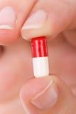 pill för kapselhandholding Royaltyfria Foton