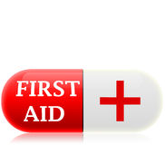 Pill first aid. The image depicts a pill, on which there is a written and first aid and a symbol with a red cross Royalty Free Stock Image