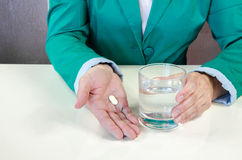 Pill in hand Stock Photos
