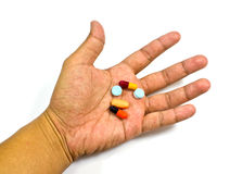 Pill in a hand Royalty Free Stock Photo