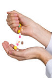 Pill in a hand Stock Images