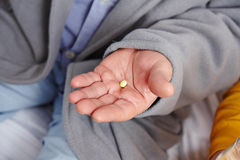 Pill on hand of old man Stock Photos