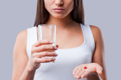 Pill in her hand. Stock Images