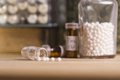 Pill with homeopathy globules. Pills  of homeopathy medicine in a table Stock Photos