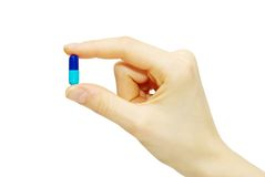 Pill In Fingers Stock Images