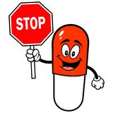 Pill Mascot with Stop Sign Stock Photos