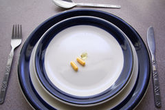 Pill Meal. A table set with 3 pills as a meal Royalty Free Stock Photos