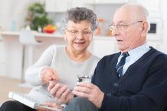 Pill medicine illness health diagnosis symptoms concept. Senior Royalty Free Stock Photo