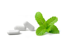 Pill and mint isolated on white background Stock Image