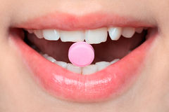 Pill in mouth Royalty Free Stock Photography