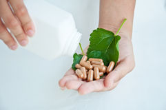 Pill from nature on white background Royalty Free Stock Photography