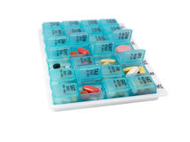 Pill organizer, long view Royalty Free Stock Image