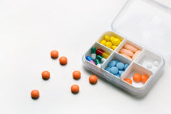 Pill in pillbox Stock Images