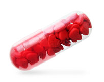 Pill with red hearts. Stock Photo