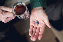 A pill in someone`s hand Royalty Free Stock Photos