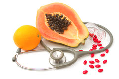 Pill and stethoscope with fruit Stock Photo