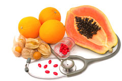 Pill and stethoscope with fruit Royalty Free Stock Photos