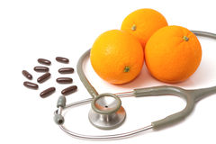 Pill and stethoscope with orange Stock Images