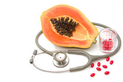 Pill and stethoscope with papaya fruit Royalty Free Stock Image
