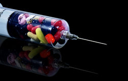 Pill in the syringe Royalty Free Stock Photos