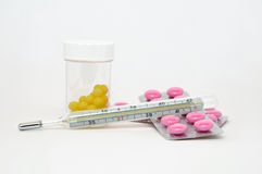 Pill, tablet, drug and thermometer Stock Image