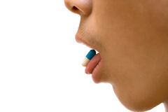 Pill on tongue Royalty Free Stock Photos