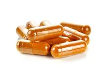 Pill.Tumeric powder capsules Royalty Free Stock Images