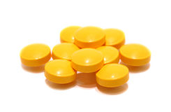 Pill of vitamin C on white background. Royalty Free Stock Image