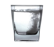 Pill in the water. Pill in glass of water Stock Photos
