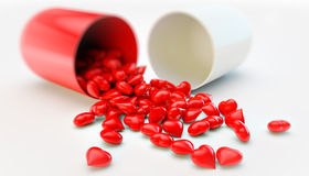 Pill With Hearts Stock Photos