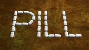 PILL WORD ON A RUSTY METAL PLATE stock photo