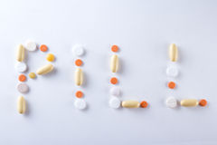 Pill word text made of colorful tablets, pills and capsules Royalty Free Stock Images