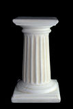 Pillar. White pillar in front of a black background Stock Photo