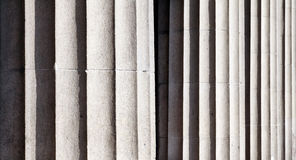 Pillar background. Vertical lines carved stone pillars background Royalty Free Stock Images