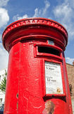 Pillar Box. LONDON, UK - MAY 24, 2014:  Red painted pillar box on the corner of a road in London Royalty Free Stock Image