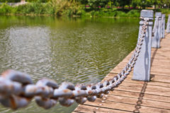 Pillar and chain fence down on a lake side. In Kunming Stock Photography